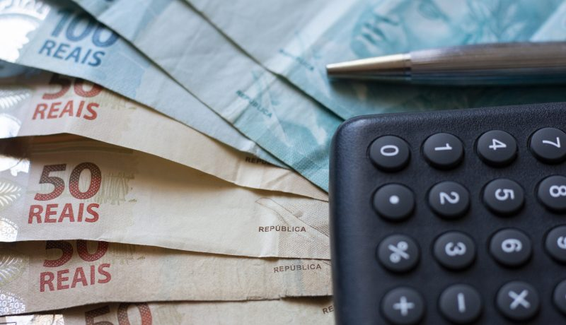 Finance Concept Calculator, Brazilian Money And Pen